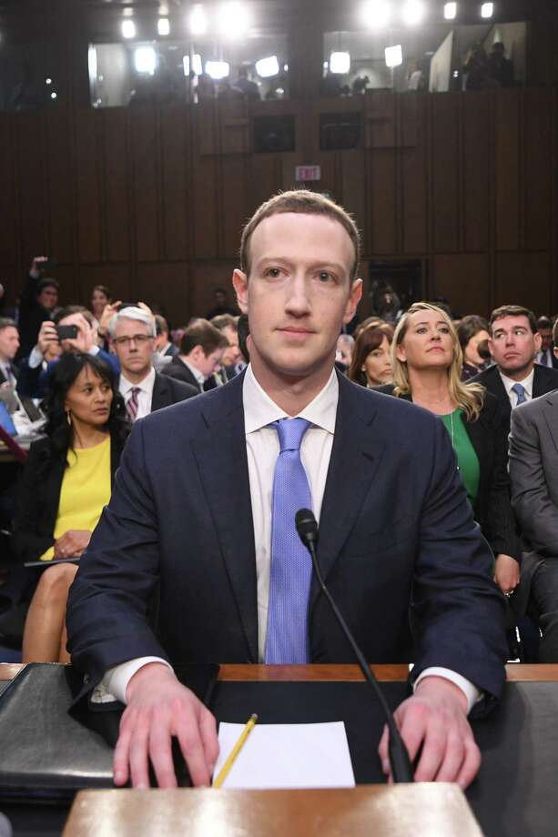 Facebook CEO Mark Zuckerberg arrives to testify before a joint hearing of the US Senate Commerce, Science and Transportation Committee and Senate Judiciary Committee on Capitol Hill, April 10, 2018 in Washington, DC. / AFP PHOTO / JIM WATSONJIM WATSON/AFP/Getty Images Photo: JIM WATSON, AFP/Getty Images / AFP or licensors