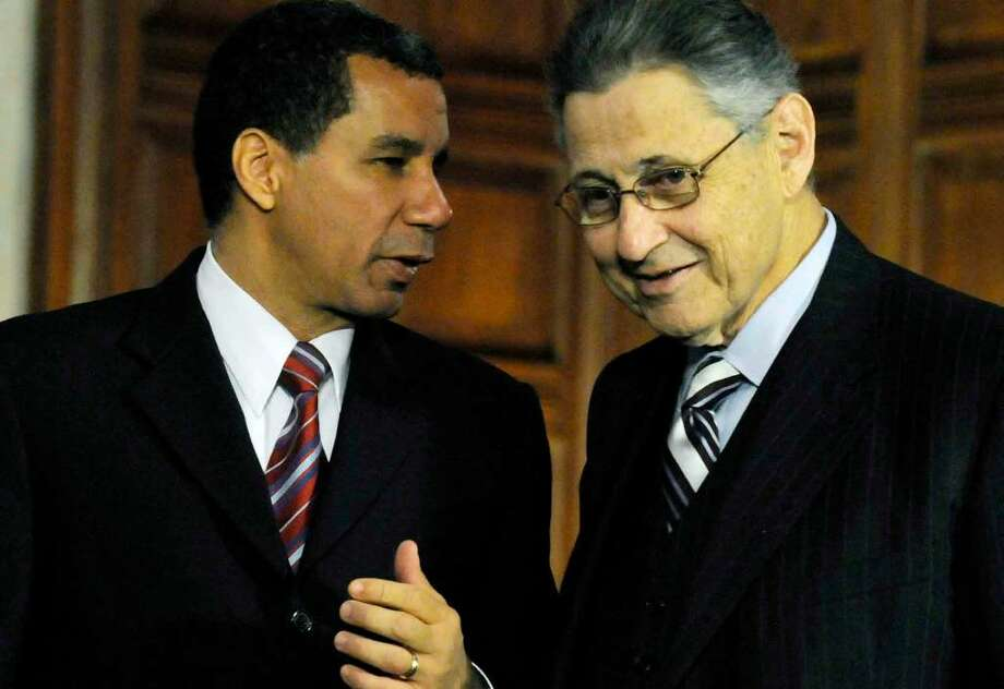 Gov. David Paterson and Assembly Speaker Sheldon Silver talk Wednesday before a leaders meeting at the Capitol. The governor has set a June 28 deadline for the budget to be approved. (Michael P. Farrell/Times Union) Photo: MICHAEL P. FARRELL