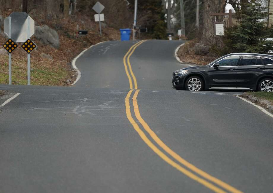 The intersection of Wheeler Road and Route 110 Shelton Road in Monroe creates an optical illusion of an unbroken double line in Monroe, Conn. on Thursday, April 5, 2018. Photo: Brian A. Pounds / Hearst Connecticut Media / Connecticut Post