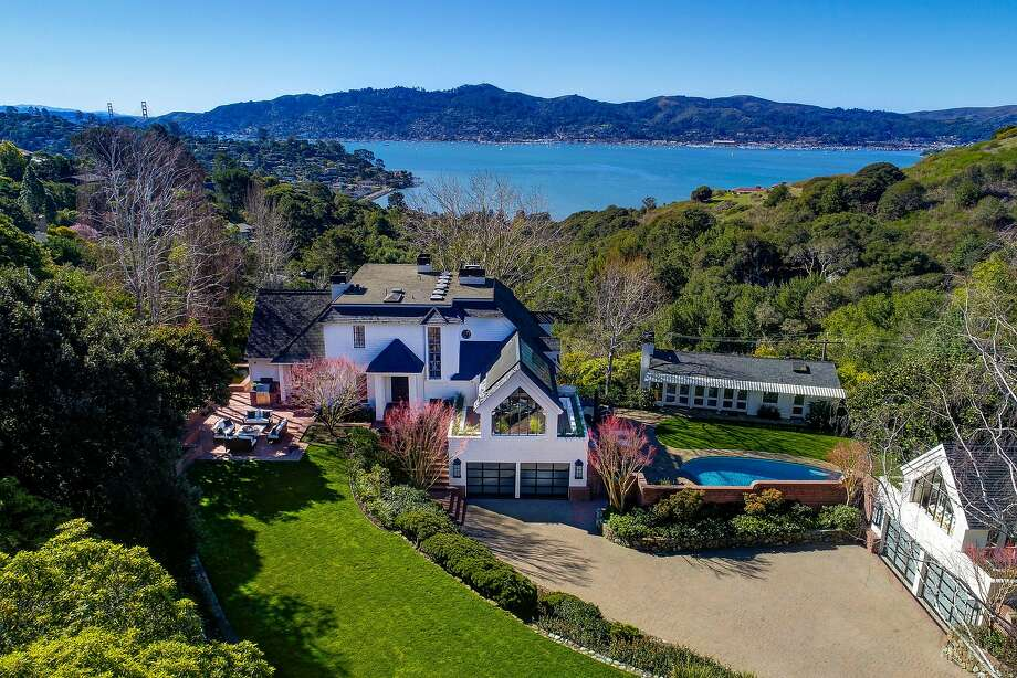 Set on nearly an acre overlooking Sausalito, Richardson Bay and the Golden Gate Bridge, this six-bedroom estate at 223 Round Hill Road in Tiburon features a trilevel East Coast-style main home. Photo: Jason Wells Photography