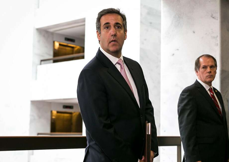 FILE-- Michael Cohen, President Donald Trump's lawyer, speaks to reporters after a closed-door meeting with the Senate Intelligence Committee on Capitol Hill in Washington, Sept. 19, 2017. Rod Rosenstein, the veteran Republican prosecutor handpicked by President Donald Trump to serve as deputy attorney general, personally signed off on the April 10, 2018, FBI decision to raid the office of  Cohen, three government officials said. (Al Drago/The New York Times) Photo: AL DRAGO, NYT