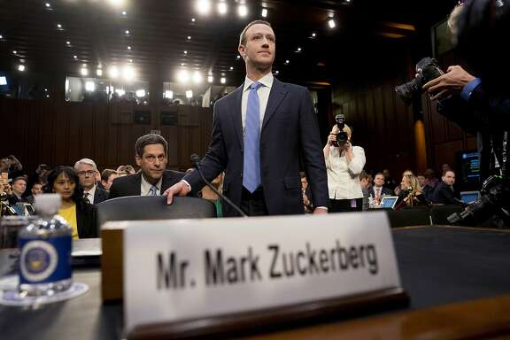 Facebook CEO Mark Zuckerberg arrives to testify before a joint hearing of the Commerce and Judiciary Committees on Capitol Hill in Washington, Tuesday, April 10, 2018, about the use of Facebook data to target American voters in the 2016 election. (AP Photo/Andrew Harnik)