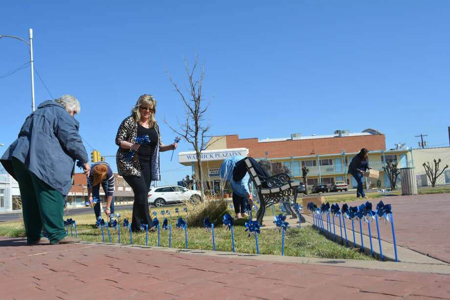 Members of the Hale County Child Welfare Board place 300 pinwheels around Millennium Park on Monday in recognition of April being Child Abuse Awareness and Prevention Month. The 300 pinwheels represent the number of reported cases of child abuse in Hale County during 2017. There were 140 children removed from abusive Hale County homes during the year. Photo: Doug McDonough/Plainview Herald