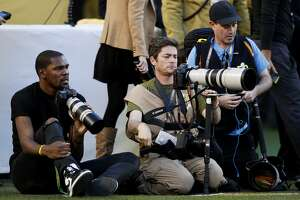 Kevin Durant takes photographs for the Players' Tribune on the field during Super Bowl 50 at Levi's Stadium on February 7, 2016 in Santa Clara, California.