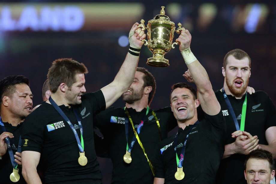Richie McCaw, left, and Dan Carter of New Zealand's All Black team hold the Webb Ellis Cup aloft following victory in the 2015 Rugby World Cup Final match between New Zealand and Australia at Twickenham Stadium on October 31, 2015, in London. Photo: Phil Walter / Getty Images / 2015 Getty Images