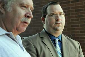 Christopher Belair, right, with his father, Stephen, talks to the press at the conclusion of his trial in 2015. More than two years after then-Danbury police officer Christopher Belair was accused of berating an undocumented immigrant and threatening to beat him during a traffic stop, a jury on Thursday found him not guilty at the Superior Court in Danbury.