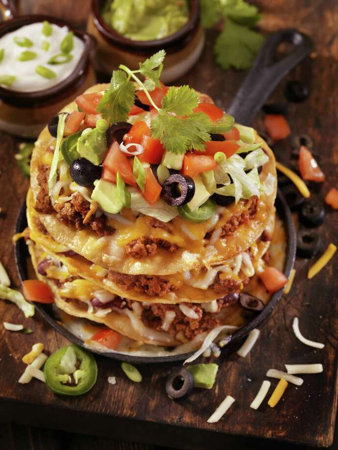 Chili Cheese Tostada Tower. In a cooking rut? Switch up Taco Tuesday for Tostada Thursday. Tostadas are basically tacos, but this time the shell is flat and the toppings are a little different. Photo: Lauri Patterson / Getty Images / Lauri Patterson