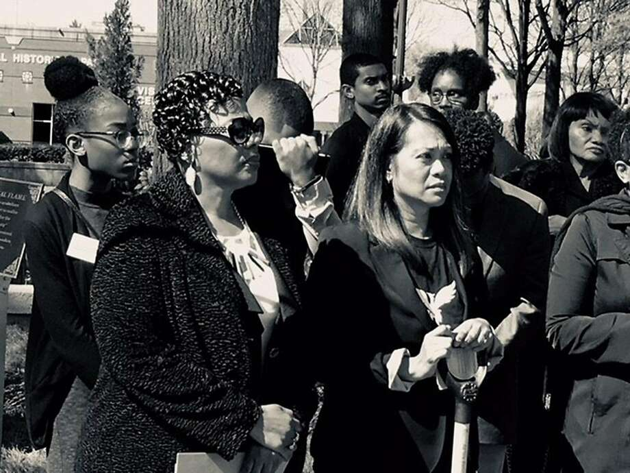 Marjory Stoneman Douglas High School student Tyah Amoy-Roberts (left) , the Rev. Bernice A. King and Pati Navalta Poblete of the Robby Poblete Founda tion take part in a ceremony to turn guns into shovels at the King center in Atlanta. Photo: Anh Solis