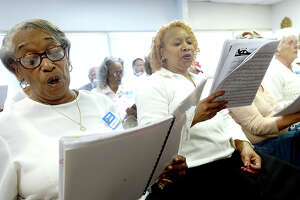 Gwendolyn Walters (left) and Gatsy Moye join members of the Volunteer Voices of Beaumont senior choir as they rehearse at the Best Years Center. The choir does weekly performances at area nursing homes and also organization lunches, including the RSVP luncheon. Photo taken Tuesday, April 10, 2018 Kim Brent/The Enterprise