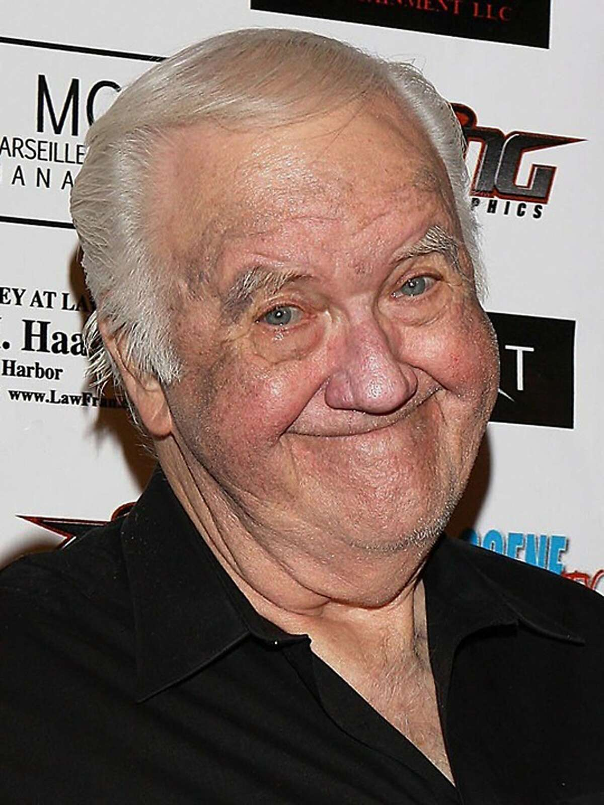 """In this Sept. 10, 2010, photo, Chuck McCann Motorcycle Charity Associates presents its 4th annual Leather Meets Lace event benefiting Iraq Star Foundation and Heroes Night Out at the Playboy Mansion Los Angeles. Actor and comedian McCann, who recorded the famous line """"I'm cuckoo for Cocoa Puffs!"""" has died. He was 83. His publicist Edward Lozzi says McCann died Sunday, April 9. 2018, of congestive heart failure in a Los Angeles hospital. (Rachel Worth/Lozzi Media Services via AP)"""