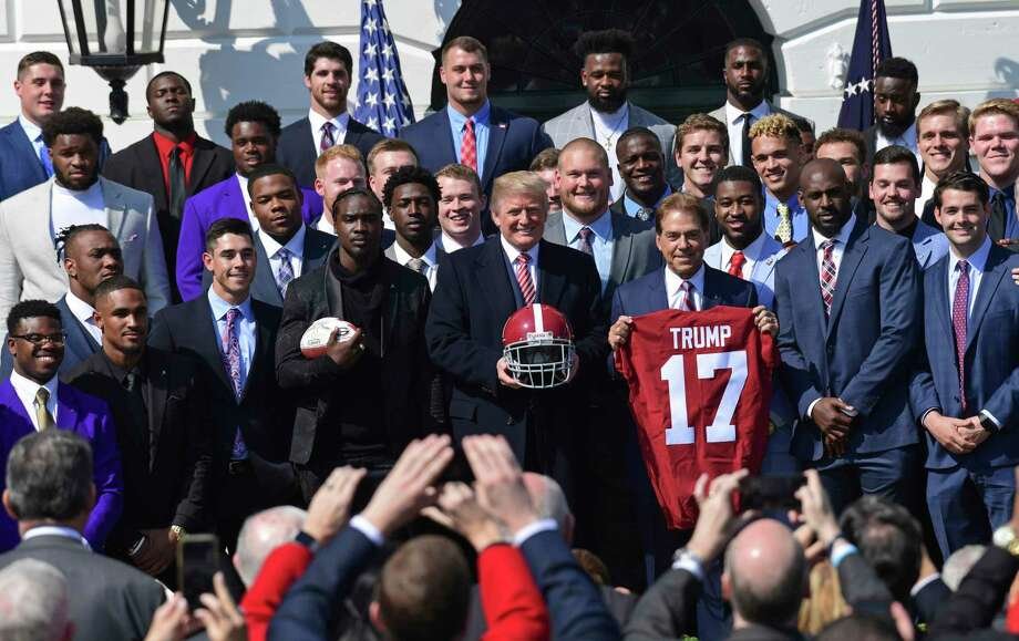 President Donald Trump, center, poses for a photos with the 2017 NCAA National Champion University of Alabama football team at the White House in Washington, Tuesday, April 10, 2018. Head coach Nick Saban told the Trump jersey. (AP Photo/Susan Walsh) Photo: Susan Walsh, Associated Press / Copyright 2018 The Associated Press. All rights reserved.