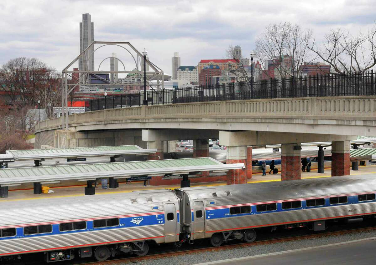 Passengers board an Amtrak train bound for New York City at the Rensselaer Train Station on Tuesday, April 10, 2018, in Rensselaer, N.Y. Amtrak said Tuesday that construction on critical infrastructure repairs in the New York City area will will mean that train service out of Rensselaer will re-route to Grand Central Station this summer instead of Penn Station. (Paul Buckowski/Times Union)