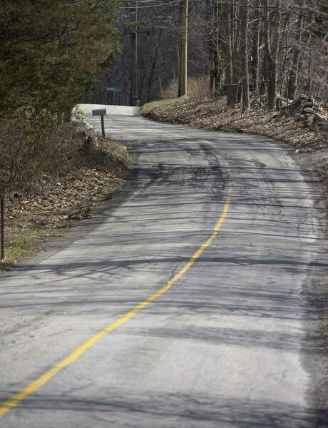 Long Mountain Road is slated to be repaired Photo: H John Voorhees III, Hearst Connecticut Media / The News-Times
