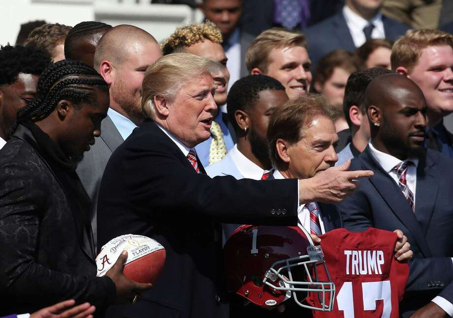 WASHINGTON, DC - APRIL 10:  U.S. President Donald Trump poses for a picture during an event to honor the 2017 NCAA Football National Champion Alabama Crimson Tide, at the White House, on April 10, 2018 in Washington, DC. Alabama beat the Clemson Tigers 35-31 to capture the championship. Photo: Mark Wilson, Getty Images / 2018 Getty Images