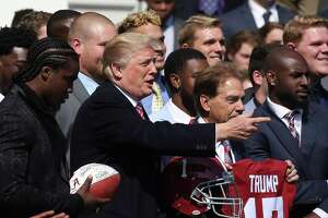 WASHINGTON, DC - APRIL 10:  U.S. President Donald Trump poses for a picture during an event to honor the 2017 NCAA Football National Champion Alabama Crimson Tide, at the White House, on April 10, 2018 in Washington, DC. Alabama beat the Clemson Tigers 35-31 to capture the championship.