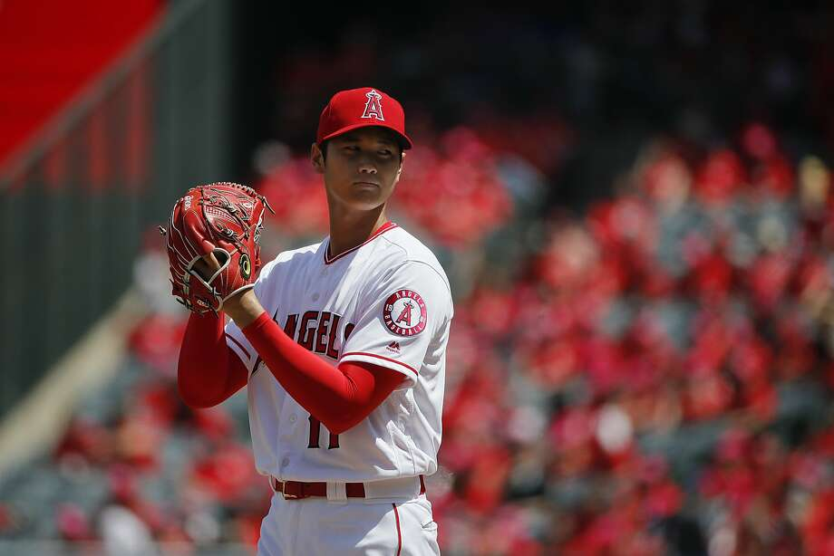 Los Angeles Angels starting pitcher Shohei Ohtani reads the sign while throwing against the Oakland Athletics on April 8, 2018, in Anaheim. Photo: Jae C. Hong / Associated Press