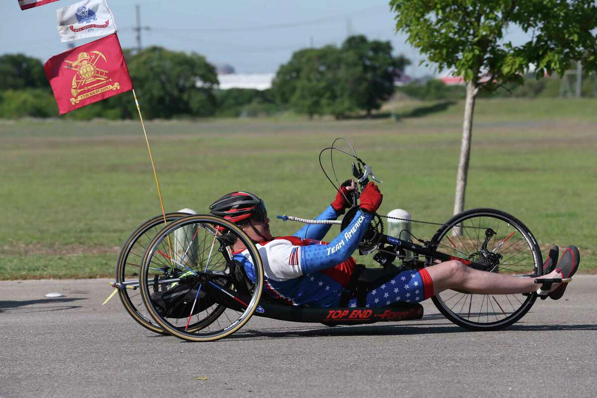 James Madison, 50, participates in a three-day cycling camp for wounded, ill and injured service members and veterans at McAllister Park, Tuesday, April 10, 2018. South Texas VA Recreation Therapy Service partnered with Operation Comfort to host it. The camp started on Monday and provided them an opportunity to ride adaptive cycles to meet their disability. For many, riding a standard bicycle is difficult due to neurological or physical injuries that affect balance and/or mobility. Therapists have found cycling benefits include improved fine motor skills, increased immune system activity, reductions in blood pressures, pain, social anxiety and it also prevents social isolation and depression. Operation Comfort also host weekly bicycle rides on Wednesday.