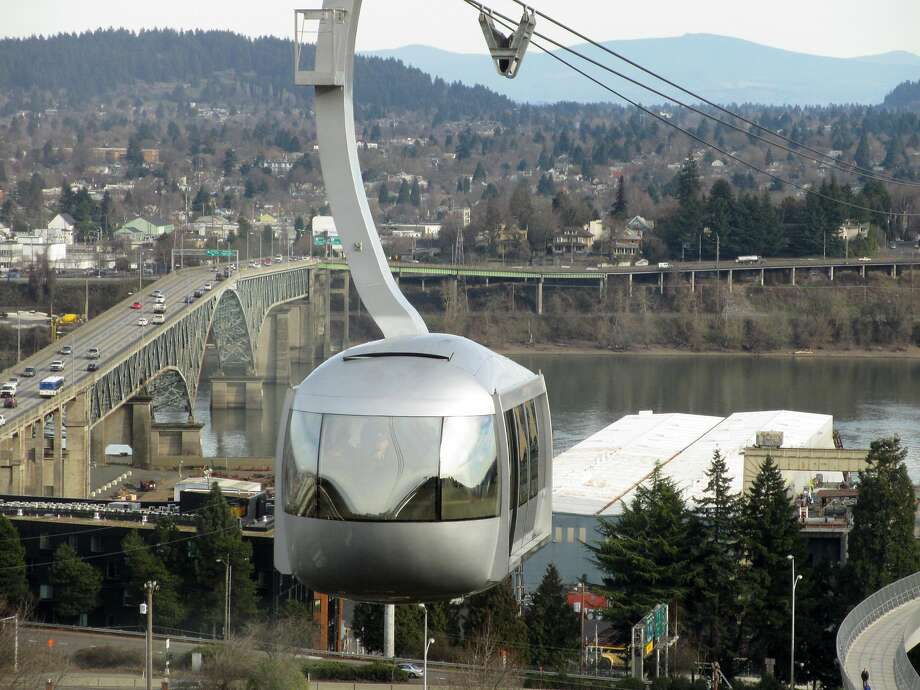 A $4 ticket for the Portland Aerial Tram gets you a ride up 3,300 linear feet to the hillside location of the Oregon Health & Science University�s main campus. Photo: Jennifer R. Lloyd / San Antonio Express-News