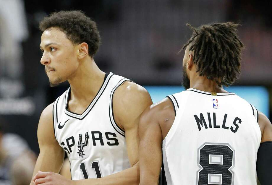 San Antonio Spurs guard Bryn Forbes (11) celebrates with teammate guard Patty Mills (8) after a basket during second half action against the Sacramento Kings Monday April 9, 2018 at the AT&T Center. The Spurs won 98-85. Photo: Edward A. Ornelas, Staff / San Antonio Express-News / © 2018 San Antonio Express-News