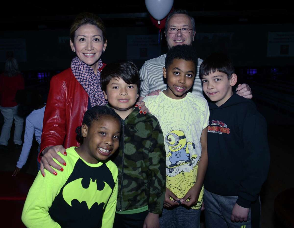 Mentors Lucia Rilling and Simon Verney with mentees Styles, Jason, Jordan and Thomas. All are part of the Norwalk Mentor Program.