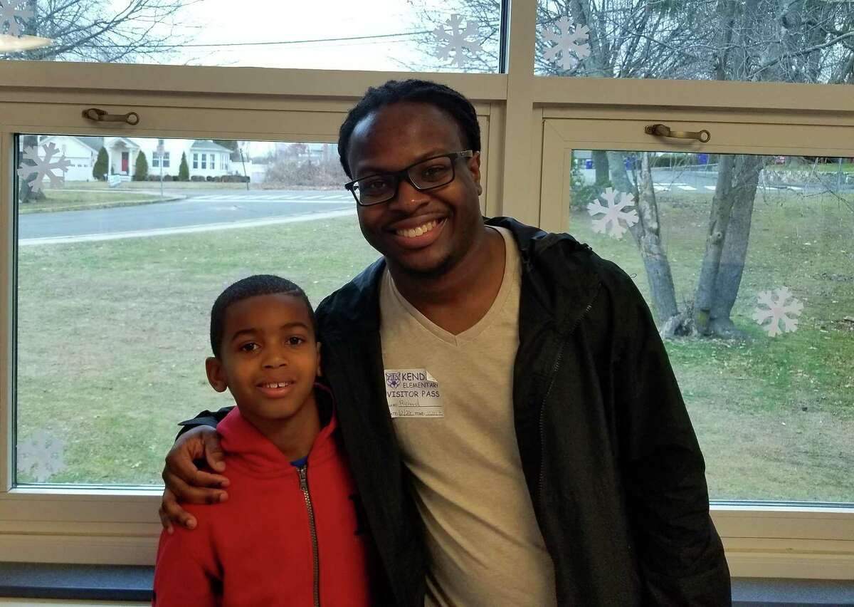 Richard Collins, a former mentee of the Norwalk Mentor Program, with his mentee Kelvin.