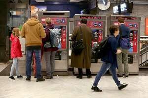 Muni riders buy tickets at the Civic Center station on Tuesday, April 10, 2018, in San Francisco, Calif.