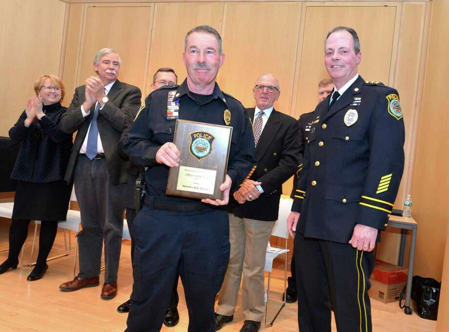 """Wilton Police Chief John Lynch, right, presents Detective Kip Tarrant with the 2017 Officer of the Year Award, in memory of Sgt. Thomas """"TJ"""" Tunney, during the department's awards ceremony. Photo: Alex Von Kleydorff / Hearst Connecticut Media / Norwalk Hour"""