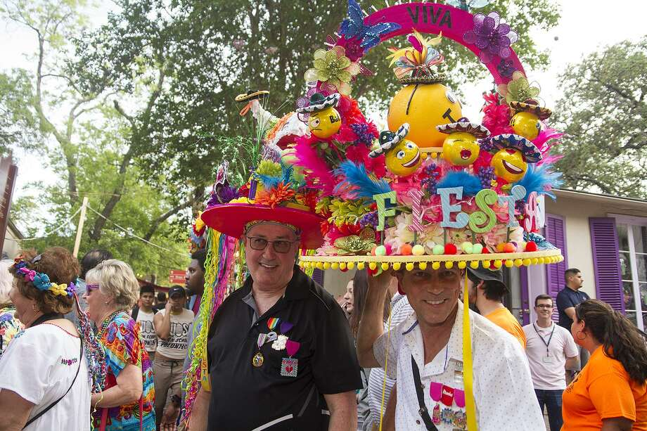 Hats, the bigger the better, are a welcome sight at NIOSA. Here, Guy Prichard (left) and Tye Wichert rock the tradition in head wear they made for Fiesta on April 25, 2017. Photo: Alma E. Hernandez / For The Express-News