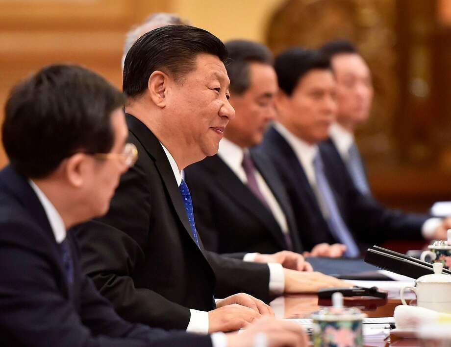 Chinese President Xi Jinping (second from left) discusses trade during a meeting in Beijing. Photo: Madoka Ikegami / AFP / Getty Images