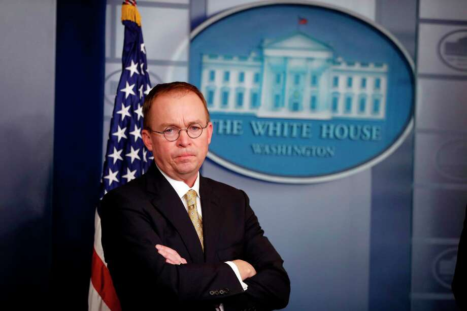FILE- In this Jan. 20, 2018, file photo, Director of the Office of Management and Budget Mick Mulvaney stands during a press briefing at the White House in Washington. Mulvaney, appointed acting director of the Consumer Financial Protection Bureau in November, promised to shrink the bureau's mandate and take a much softer approach to enforcement, and records reviewed by The Associated Press indicate he has kept his word. (AP Photo/Alex Brandon, File) Photo: Alex Brandon / Copyright 2018 The Associated Press. All rights reserved.