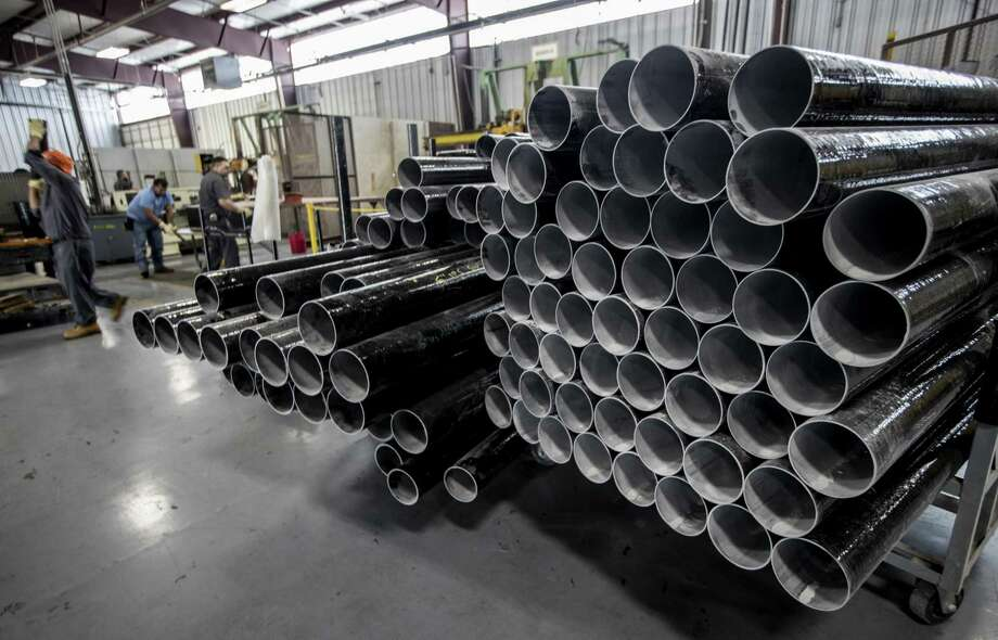 Fiberglass pipes are stacked at Champion Fiberglass. Manufacturing activity in Houston expanded in January for the 17th consecutive month and overall economic activity expanded for the 30th month, the Institute for Supply Management said.    ( Brett Coomer / Houston Chronicle ) Photo: Brett Coomer, Staff / Houston Chronicle / © 2018 Houston Chronicle