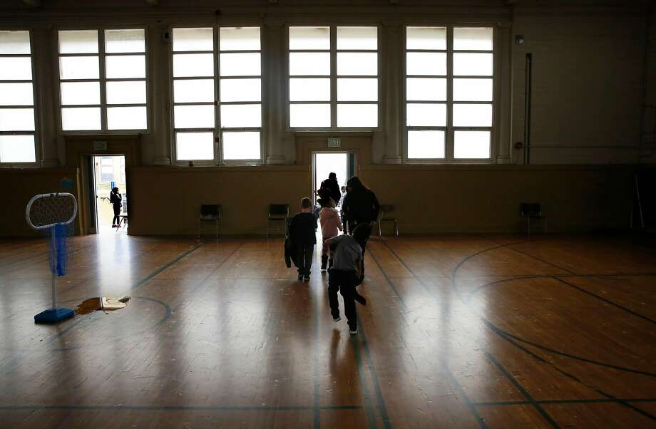 Students exit the gymnasium after class where the shelter would be located at Buena Vista Horace Mann K-8 school. Photo: Michael Macor / The Chronicle