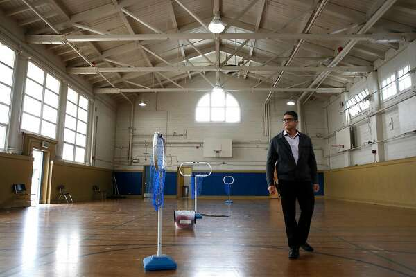 Principal Richard Zapien, walks the floor of the gymnasium, where the shelter would be located at Buena Vista Horace Mann K-8 school in San Francisco, Calif. This San Francisco public school is considering opening a family homeless shelter in one of the gyms to house students and their families who are homeless or need emergency shelter.