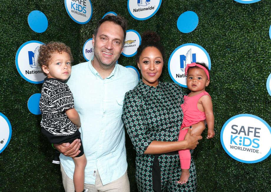(L-R) Journalist Adam Housley, Aden John Tanner Housley, actress Tamera Mowry-Housley, and Ariah Talea Housley attend Safe Kids Day at Smashbox Studios on April 24, 2016 in Culver City, California.  Photo: (Photo By Rich Polk/Getty Images For Safe Kids Worldwide)