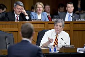 Senator John Kennedy, a Republican from Louisiana, questions Mark Zuckerberg, chief executive officer and founder of Facebook Inc., left, during a joint hearing of the Senate Judiciary and Commerce Committees in Washington, D.C., U.S., on Tuesday, April 10, 2018. Zuckerberg apologized, defended his company, and jousted with questioners while agreeing with others during his first-ever congressional testimony. Early reviews on his effort to restore trust with lawmakers and the public were mostly positive. Photographer: Andrew Harrer/Bloomberg