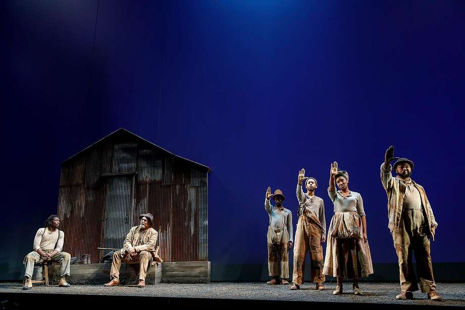 "Members of the company of ""Father Comes Home from the Wars (Parts 1, 2 & 3),"" a coproduction between ACT and Yale Repertory Theatre. Photo: Joan Marcus / ACT And Yale Repertory Theatre"