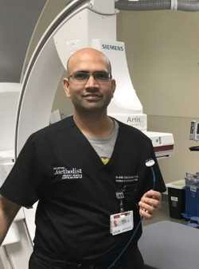 Dr. Rajesh Venkataraman holds a WATCHMAN LAAC Implant at Houston Methodist The Woodlands Hospital. Photo: Courtesy Photo