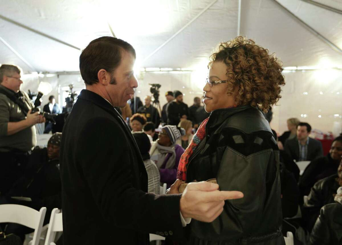 Houston's director of Housing & Community Development Department Tom McCasland talks to Tarsha Jackson, with the organization the Texas Organizing Project, during a celebration for the rehabilitation of the Cleme Manor affordable housing complex in the Fifth Ward, Monday, Dec. 19, 2016, in Houston. ( Mark Mulligan / Houston Chronicle )