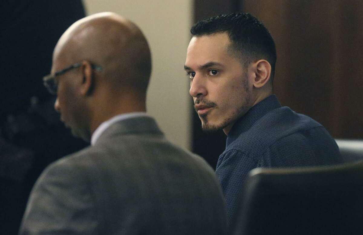Adrian Vigil (right) sits in 187th state District Court with his defense attorney David Woodard (left) Tuesday April 10, 2018. He is accused of super aggrevated sexual asault of a child, allegedly giving a 1-year-old child and a 3-year-old child a sexually transmitted disease.
