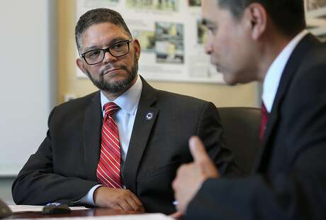 The California Department of Motor Vehicles (DMV) chief counsel Brian Soublet (left) and DMV  deputy director  Bernard Soriano (right) speak at the California DMV on Friday, April 6, 2018, in Sacramento, Calif.
