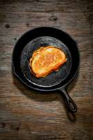 A Grilled Cheese sandwich is seen in a cast iron pan on Wednesday, April 4, 2018 in San Francisco, Calif.