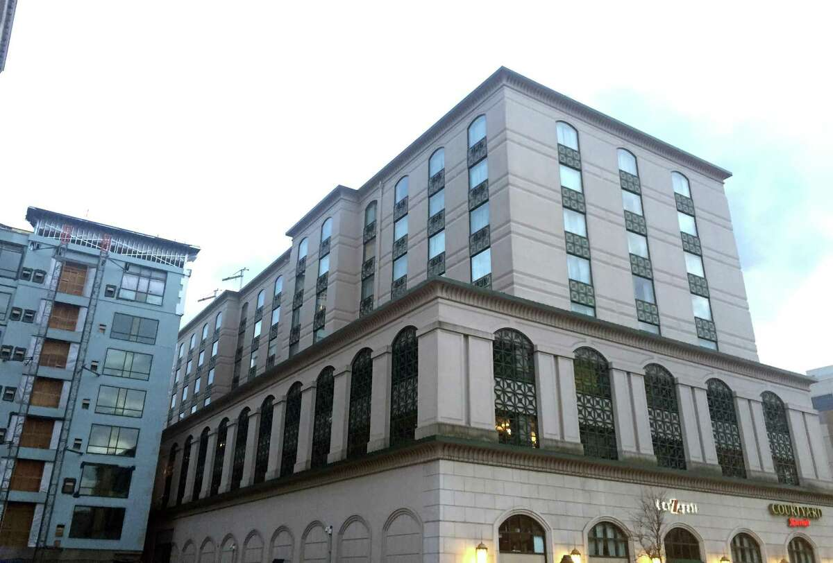 A view of the Courtyard Marriott, at right, at 275 Summer St., and the under-construction Residence Marriott at 23 Atlantic St., at left, in downtown Stamford, Conn. The two properties are former Seaboard holdings now owned by Boston-based UC Funds.