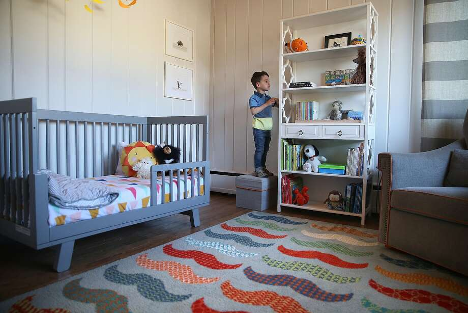 Theo, 4, in his bedroom with the mustache rug. Photo: Liz Hafalia / The Chronicle