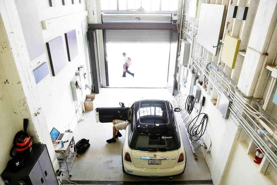 Patrick Handy installs the electronics needed to add a privately owned vehicle to the Getaround car-rental system at the company's facility in S.F. in 2014. Photo: Beck Diefenbach / Special To The Chronicle 2014