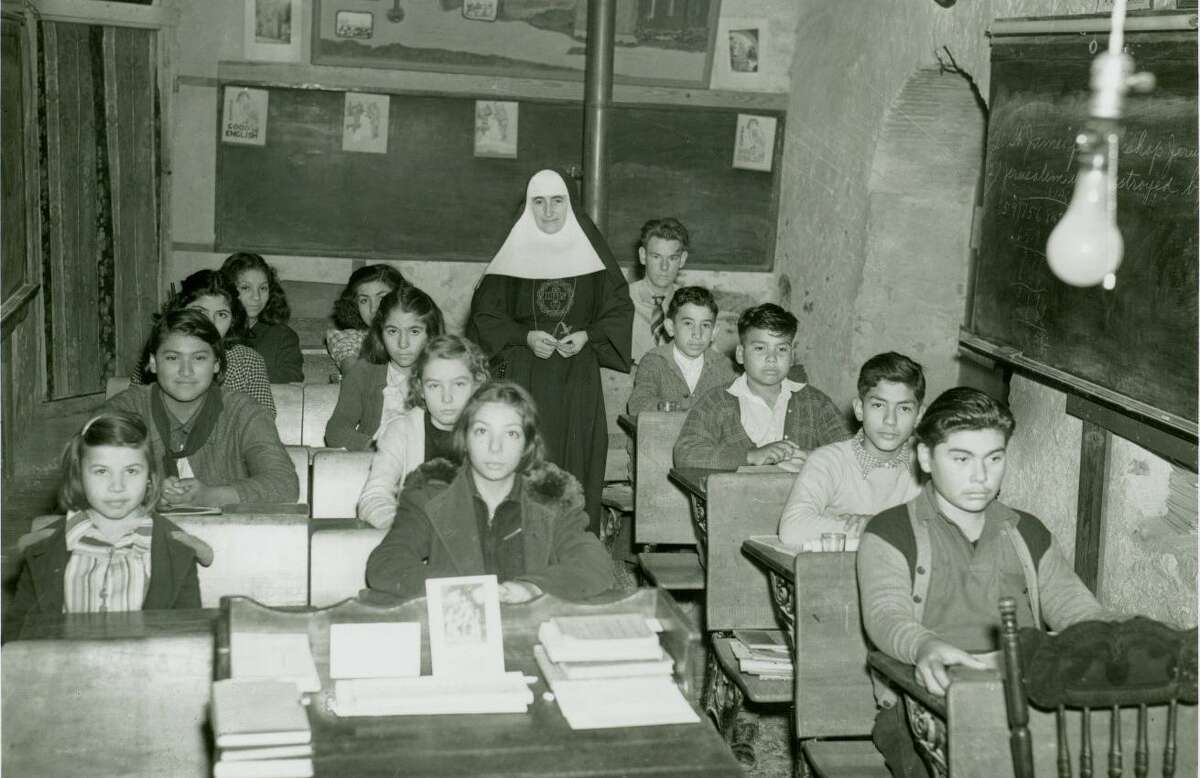 Mother Alma Neilan and students in Mission Espada School in 1942.