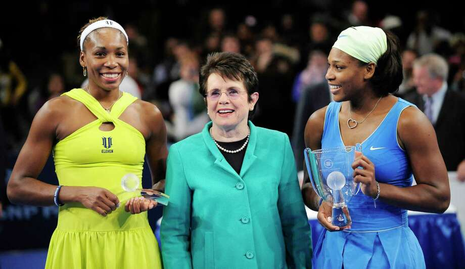 FILE - In this March 2, 2009, file photo, Billie Jean King is flanked by Venus, left, and Serena Williams after Serena defeated Venus in the championship match of the Billie Jean King Cup tennis exhibition, at Madison Square Garden in New York. Venus and Serena Williams are adding their names and voices to the push for equal pay championed by the Billie Jean King Leadership Initiative. The two current tennis stars are joining the advisory board of the group founded by the former player. (AP Photo/Stephen Chernin, File) Photo: Stephen Chernin / AP2009