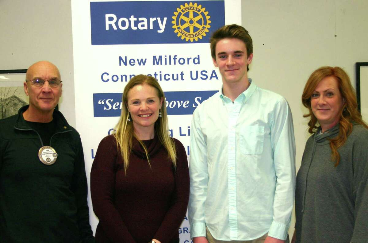 The Rotary Club of New Milford recently presented its January 2018 Student of the Month award to Ethan Trim, a senior at New Milford High School. Ethan is a member of the math, Spanish and national honor societies, plays varsity soccer, is a member of the Key Club, participates in after-school tutoring, and volunteers at youth camp and the Soccer Club of New Milford. Ethan plans to major in psychology and business toward a career as an industrial, organizational psychologist. Above, Ethan is shown with, from left to right, Rotarian Tom McSherry, NMHS teacher Jennifer Lacava and Ethans mom, Kelly Parker.