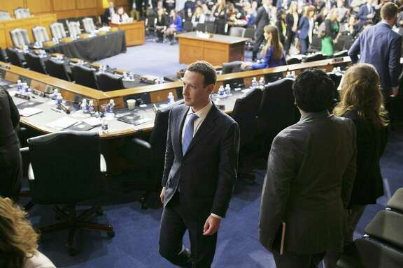 Mark Zuckerberg, the chief executive of Facebook, departs after a joint hearing with the Senate Judiciary and Commerce committees on Capitol Hill in Washington Tuesday. He returns to the Capitol building for a House committee hearing Wednesday.