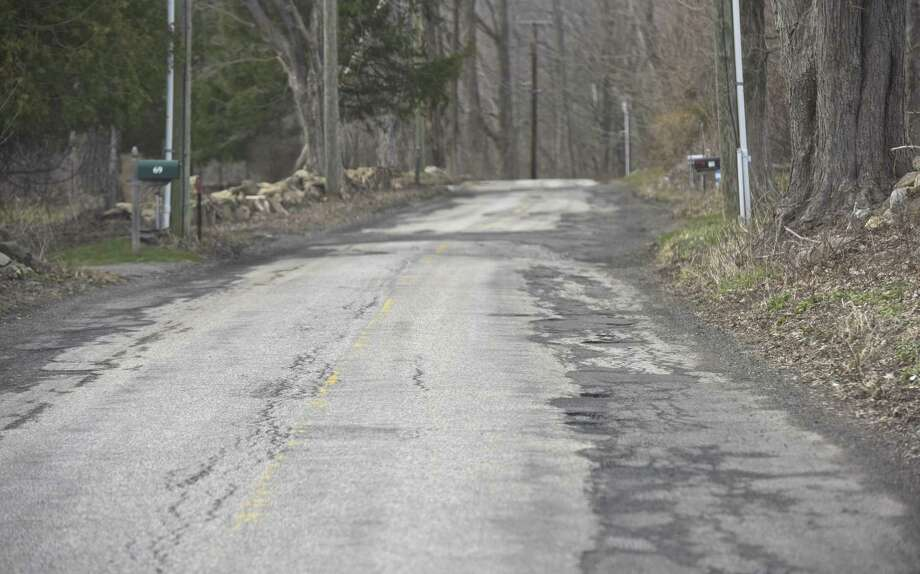 Squire Hill Road in New Milford is slated to be repaired after residents on Monday approved a $6 million bond to pay for the work. Photo: H John Voorhees III / Hearst Connecticut Media / The News-Times
