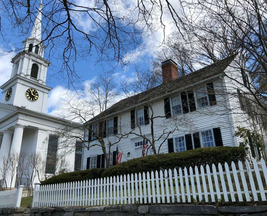 Spectrum/Applebrook Auctions in New Milford will hold an online auction including items from the historic 34 Main St. home of the late Charles Barlow April 26, 2018. The house is located next to the iconic First Congregational Church, at left, and two doors down from St. Johns Episcopal Church. aque on the corner of the house reads 1774 Built by Col. Nathaniel Taylor. Photo: Deborah Rose / Hearst Connecticut Media / The News-Times  / Spectrum